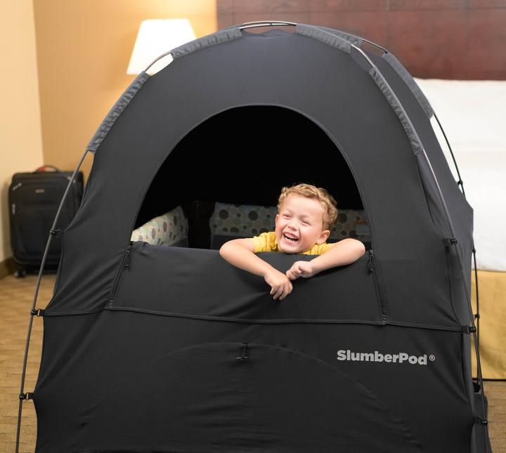 The Slumberpod is a blackout tent that pops over top of pack and plays or toddler beds.